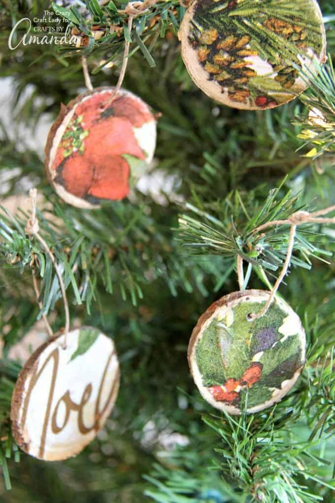 Decoupaged wooden slice ornaments